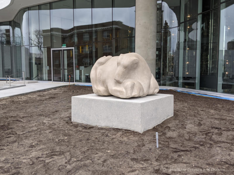 Large stone sculpture of a family of bears called Time to Play by Inuit artist Anghik Ruben