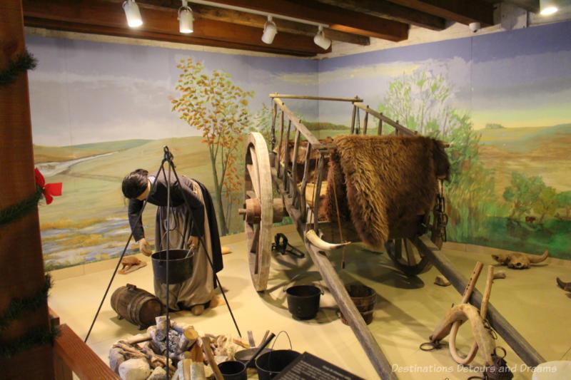 Diorama of a Métis hunting camp, including a replica of a Red River Cart.