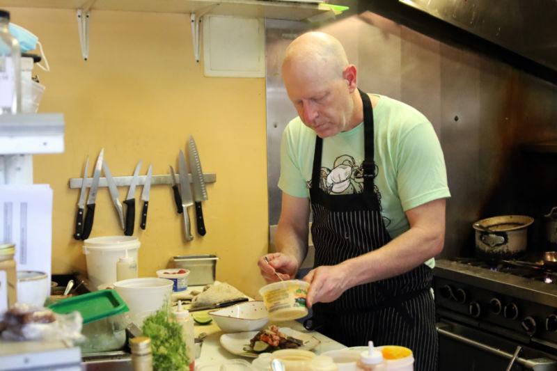 Chef Tim Payne cooking at Coho Restaurant on San Juan Island. Photo courtesy of Coho Restaurant and San Juan Islands Visitors Bureau