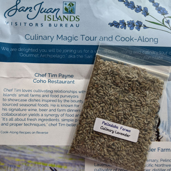 A small packet of culinary lavender from Pelindaba Farms on top of a cook-along brochure
