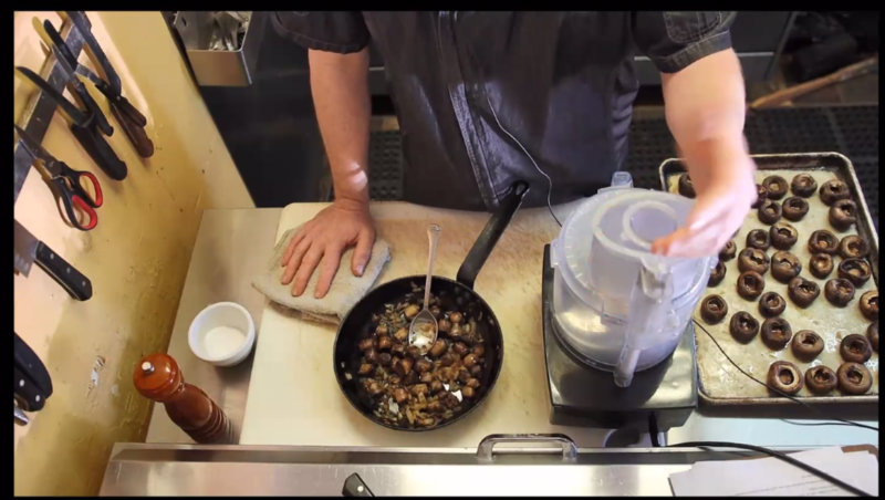 Screen shot of a chef preparing stuffed mushrooms