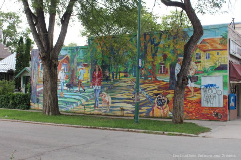 Mural on the side of a building showing life across the seasons in the Wolseley neighbourhood of Winnipeg