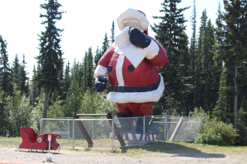 Giant Santa with a list statue