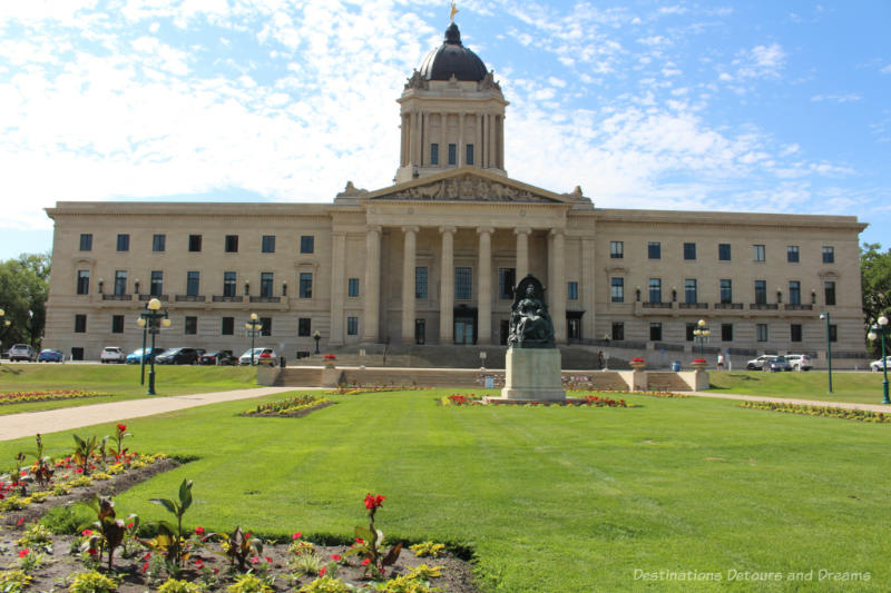 Beaux-Arts Classical Tyndall stone-covered Manitoba Legislative Building and the beautiful lawn in front of it