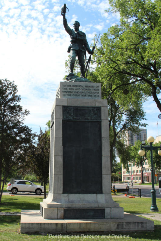 Statue of a soldier holding his helmet in a wave or welcome to remember the Winnipeg lives lost in the Great War