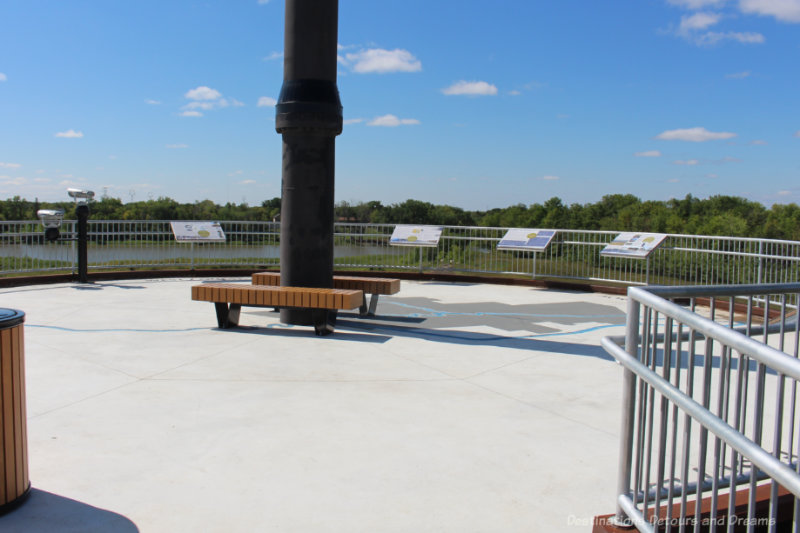 Viewing platform with panels of information overlooking prairie and Red River Floodway