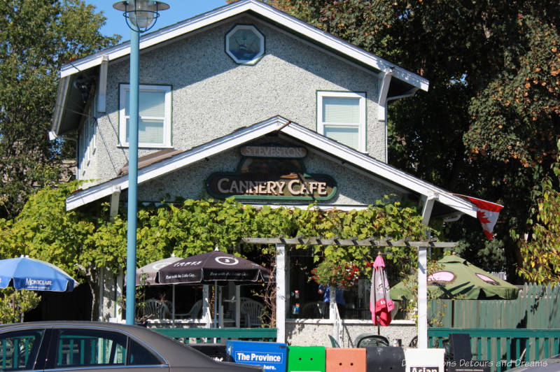 Vine covered cafe located in historic building with patio in front in Steveston, British Columbia