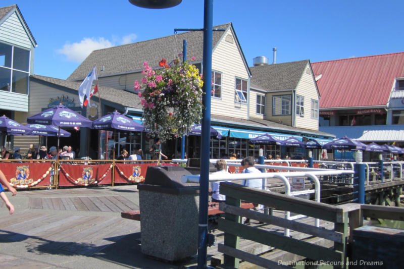 Restaurants with patios along the waterfront boardwalk in Steveston Village, British Columbia