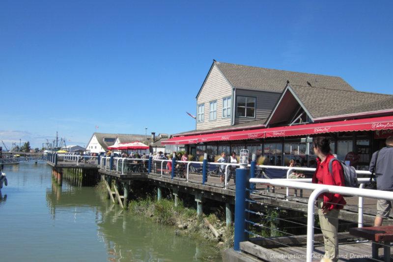 Waterfront boardwalk lined with restaurants in Steveston, British Columbia