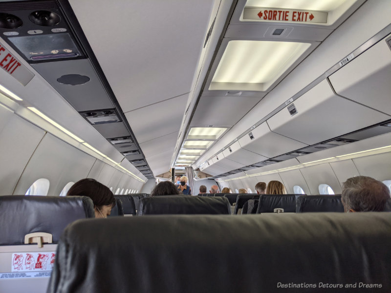 Inside the passenger cabin of an airplane as passengers board