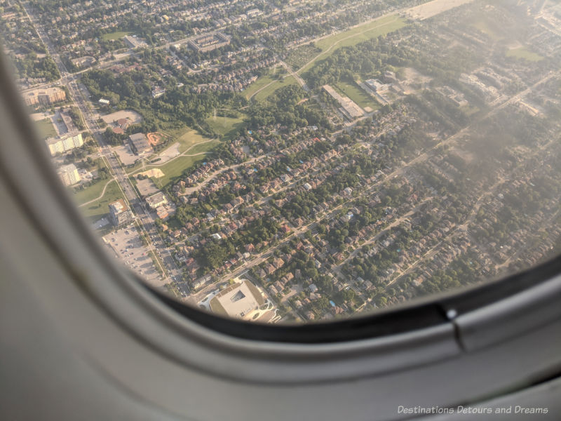 View of a city from the window of a plane - return to travel, what is it like?
