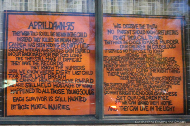 Art piece featuring a poem about residential schools on an orange background