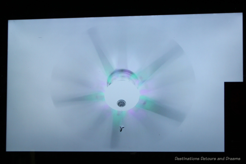 An art piece showing a whirling light fan changing colours